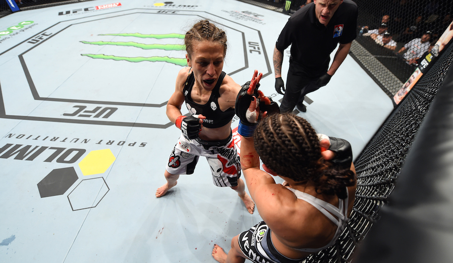 Joanna Jedrzejczyk of Poland punches Jessica Penne of the United States in their women's strawweight championship bout during the UFC Fight Night event at the O2 World on June 20, 2015 in Berlin, Germany. (Photo by Josh Hedges/Zuffa LLC/Zuffa LLC via Getty Images)