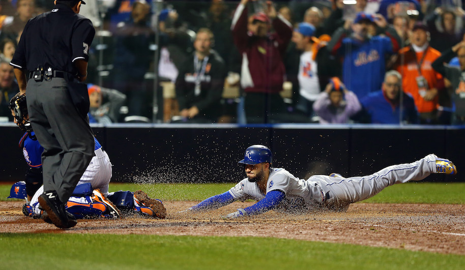 Royals first baseman Eric Hosmer slides into home to tie Game 5 against the Mets in the 9th inning Sunday night. Photo: Getty