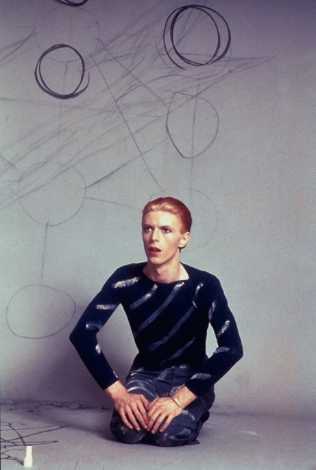 David seated drawing circles on the background paper and then the Kabbalah Tree of Life diagram on the floor. Los Angeles, 1974.