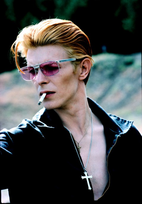 """David with cigarette on a break from filming """"The Man Who Fell to Earth"""" in New Mexico, 1975. This became a Rolling Stone cover and a popular image."""