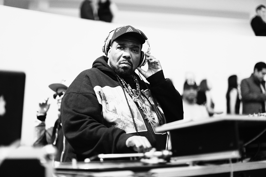 NEW YORK, NY - MARCH 19: (EDITORS NOTE: Image has been converted to black and white.) DJ Afrika Bambaataa performs during the 2015 Guggenheim Young Collectors party supported by David Yurman at Guggenheim Museum on March 19, 2015 in New York City.
