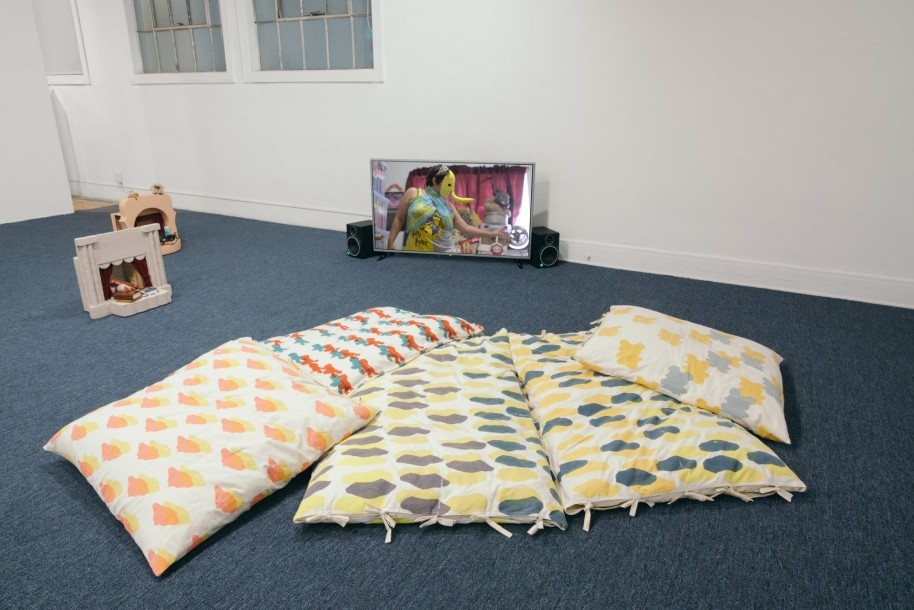 """Installation view of """"Everything is in its place, but Everything is everywhere"""" (2016), video + """"Printed Pillows"""""""