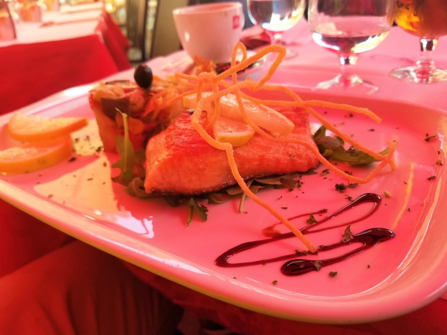 Salmon comes drizzled in Ancora's secret sauce. Photo by Akil Wingate.