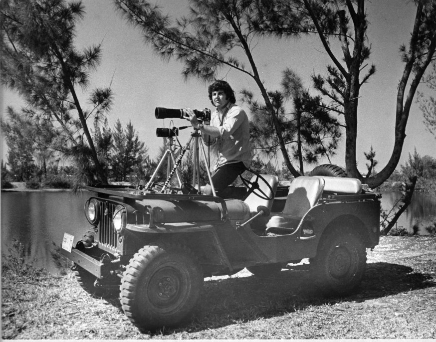 Tim Chapman with double camera set-up in his army jeep, circa 1970s.