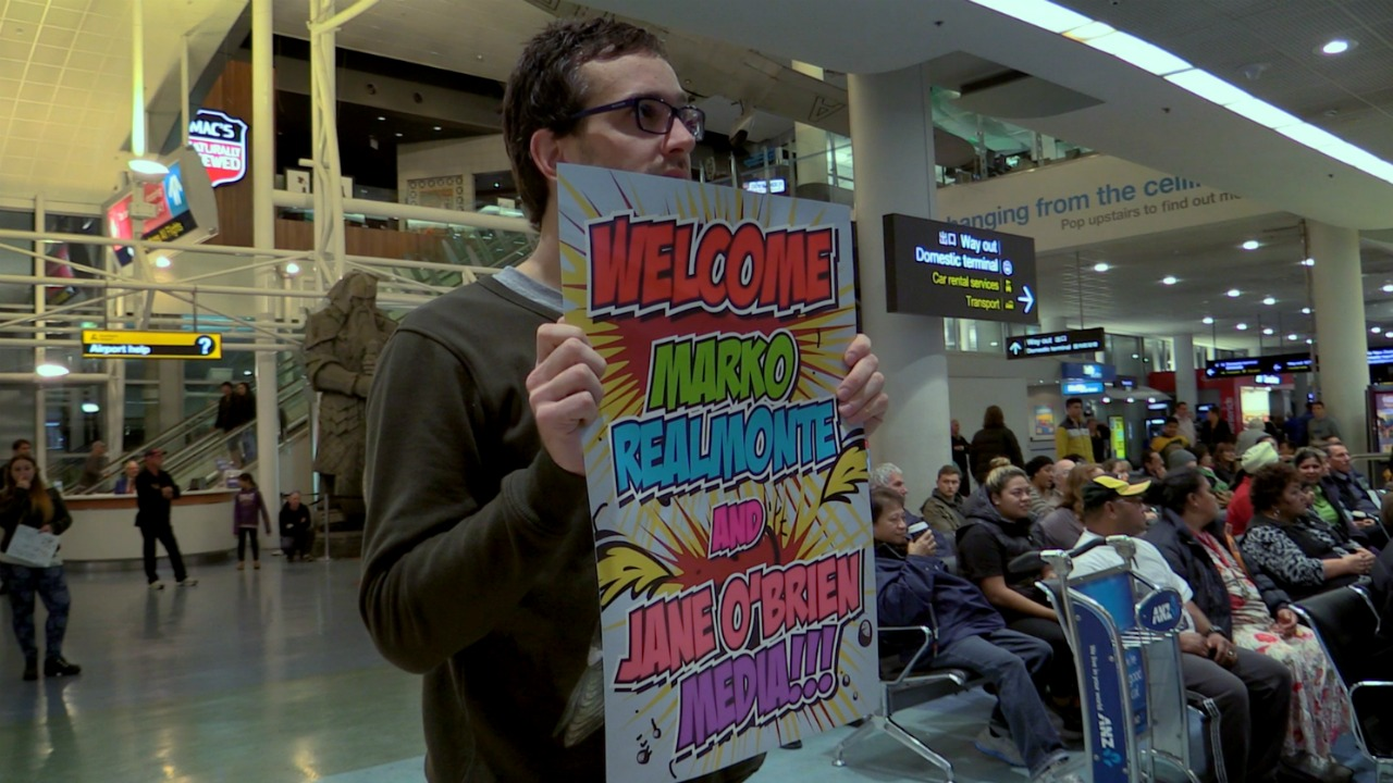 Director David Farrier greeting the legal team from Jane O'Brien Media at Auckland airport