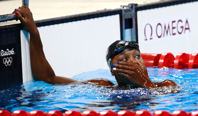 RIO DE JANEIRO, BRAZIL - AUGUST 11: Simone Manuel of the United States celebrates after winning gold in the Women's 100m Freestyle Final on Day 6 of the Rio 2016 Olympic Games at the Olympic Aquatics Stadium on August 11, 2016 in Rio de Janeiro, Brazil. (Photo by Adam Pretty/Getty Images)