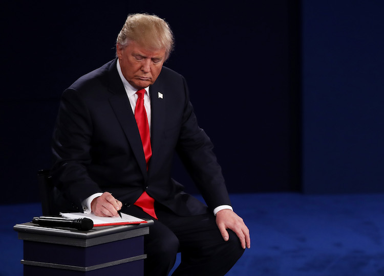 ST LOUIS, MO - OCTOBER 09: Republican presidential nominee Donald Trump takes notes during the town hall debate at Washington University on October 9, 2016 in St Louis, Missouri. This is the second of three presidential debates scheduled prior to the November 8th election. (Photo by Win McNamee/Getty Images)