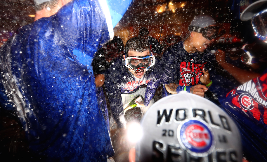 Anthony Rizzo #44 of the Chicago Cubs celebrates with teammates in the clubhouse after defeating the Los Angeles Dodgers in Game 6 of the NLCS at Wrigley Field on Saturday, October 22, 2016 in Chicago, Illinois. (Photo by Alex Trautwig/MLB Photos via Getty Images)