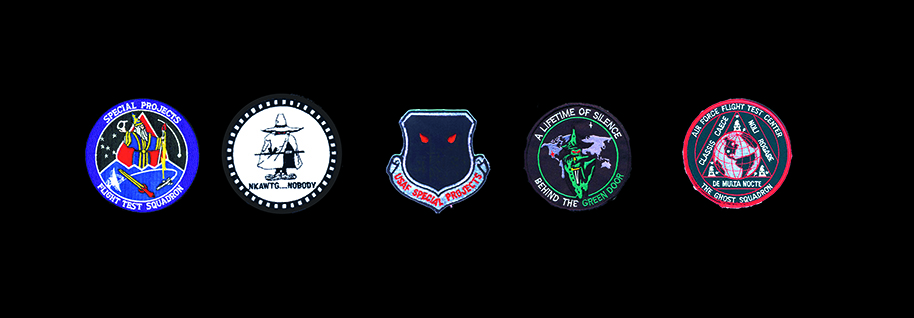Trevor Paglen, Five Classified Squadrons, ongoing. Five fabric patches, framed, 15 1/4 x 32 3/4 x 2 1/4 inches overall.