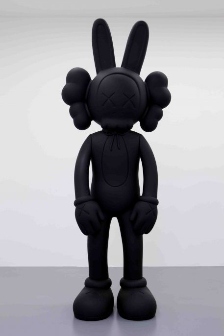 KAWS. ACCOMPLICE, 2010. Fiberglass and black rubberized paint Overall: 120 x 47 1/2 x 36 in. (304.8 x 120.65 x 91.44 cm)