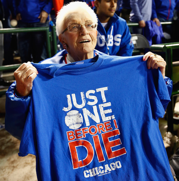 CHICAGO, IL - OCTOBER 22: Dorothy Farrell of Chicago, IL poses with a t-shirt after the Chicago Cubs defeated the Los Angeles Dodgers 5-0 in game six of the National League Championship Series to advance to the World Series against the Cleveland Indians at Wrigley Field on October 22, 2016 in Chicago, Illinois. (Photo by Jamie Squire/Getty Images)