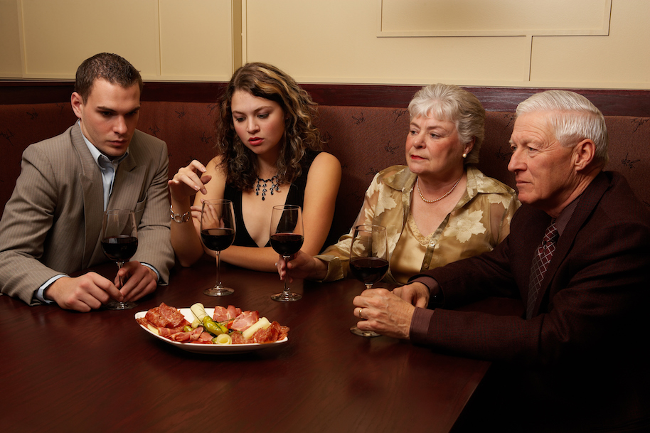 Disinterested couples at dinner. Photo: Jupiterimages (Getty).