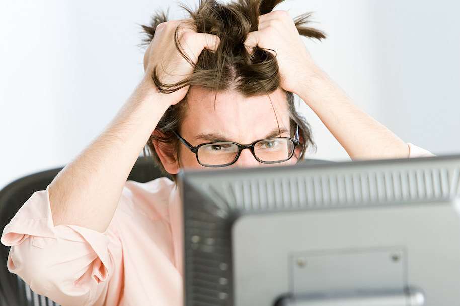 Stressed businessman. Photo: Image Source (Getty).