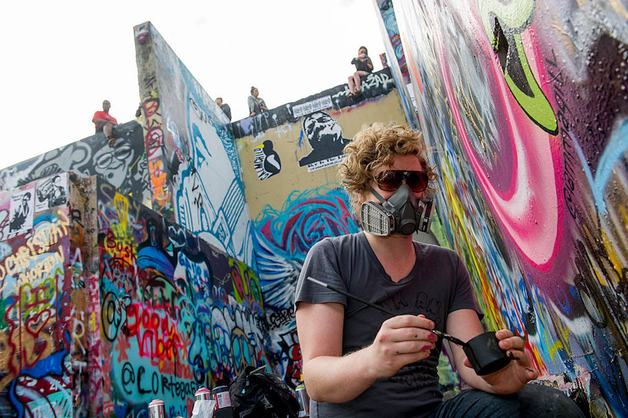 AUSTIN, TX - MARCH 12: Matt Magill, a local artists adds, his work to the many Hope Outdoor Gallery, a legal graffiti park at Castle Hills on March 12, 2015 in Austin, Texas. Once the Texas Military Institute's castle, the foundation sat as an eyesore until it was painted over and declared a space for public art in 2011. (Photo by Ann Hermes/The Christian Science Monitor via Getty Images)