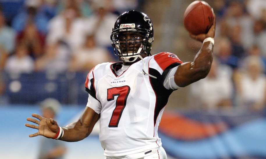 Falcons Michael Vick #7 throws during first half action between the Atlanta Falcons and the Tennessee Titans on August 26, 2006 at The Coliseum in Nashville, Tennessee.