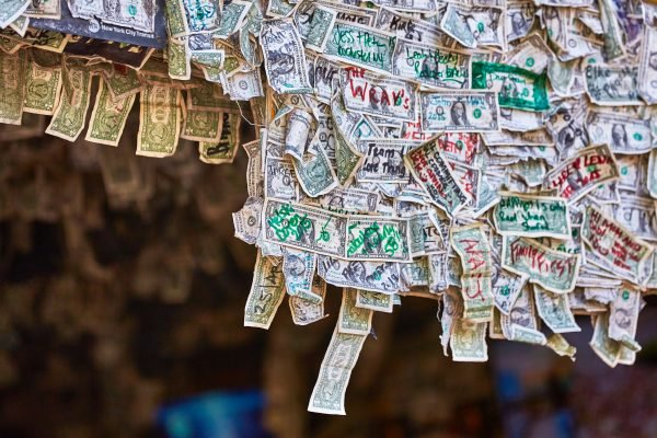 Mandatory Good News: Bar Owner Donates All the Dollar Bills Stapled to Her Walls to Furloughed Employees