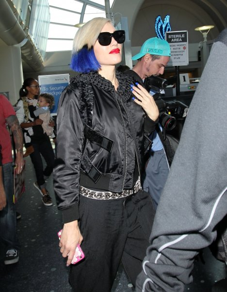 Gwen Stefani, sporting a blue dip dye hairstyle, arrives at Los Angeles International Airport (LAX)Featuring: Gwen StefaniWhere: Los Angeles, California, United StatesWhen: 18 Oct 2015Credit: WENN.com