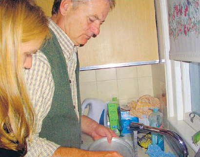 Doing the dishes for Norwegian students.